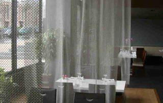 Kettenvorhang als Raumtrenner im Restaurant